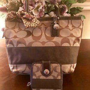 Signature coach shoulder bag and matching wallet.